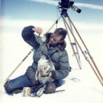 Hugo Wilmar carries a seal for his Arriflex 16mm camera during the White Wilderness production